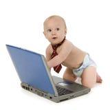 Bebé y computadora portátil Imagen de archivo libre de regalías