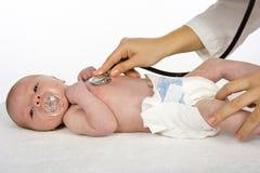 Bebé y doctor Fotografía de archivo