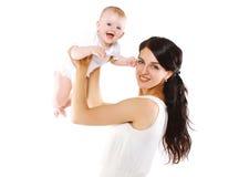 Bebé y madre alegres Imágenes de archivo libres de regalías