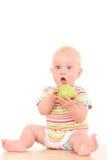 Bebé y manzana imagenes de archivo