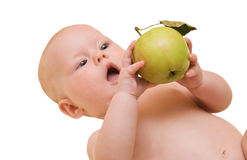 Bebé y manzana, foco en manzana Foto de archivo