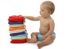 Bebé y pañal fotos de archivo