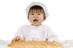 Bebé y pan Imagenes de archivo