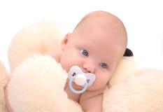 Bebé y peluche Imagen de archivo