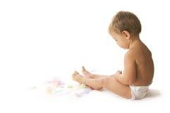 Bebé y plumas Fotografía de archivo libre de regalías