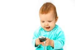 Bebé y teléfono Foto de archivo libre de regalías