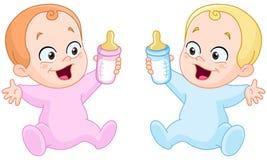 Bebés con las botellas Foto de archivo