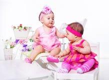 Bebés em vestidos bonitos Imagem de Stock Royalty Free