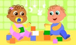 Bebés que juegan lindos Fotografía de archivo libre de regalías