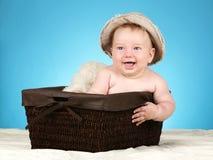 Bebê adorável na cesta de vime Imagem de Stock Royalty Free