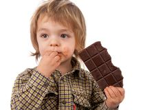 Bebê adorável que come o chocolate Imagem de Stock Royalty Free