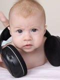 Bebê bonito com fones de ouvido Foto de Stock Royalty Free