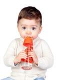 Bebê bonito com um frasco Fotos de Stock Royalty Free