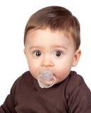 Bebê bonito com um pacifier Imagens de Stock Royalty Free