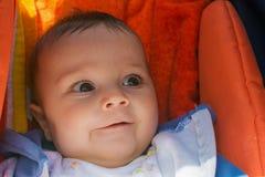 Bebê bonito em um carrinho de criança Fotos de Stock Royalty Free