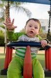 Bebê bonito em um estilingue Imagem de Stock Royalty Free