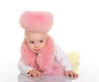 Bebê bonito na pele cor-de-rosa que encontra-se no fundo branco Imagens de Stock Royalty Free