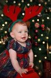 Bebê bonito no chifre da rena Imagens de Stock Royalty Free