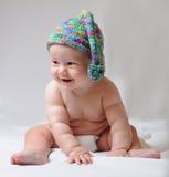 Bebê bonito no tampão Imagens de Stock Royalty Free