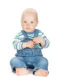 Bebê bonito pequeno nas calças de brim imagem de stock