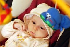 Bebê bonito que joga com brinquedos Fotografia de Stock Royalty Free