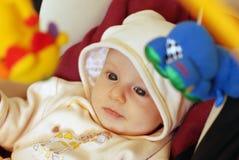Bebê bonito que joga com brinquedos Imagens de Stock Royalty Free