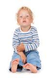 Bebê branco do cabelo encaracolado e dos olhos azuis Imagens de Stock