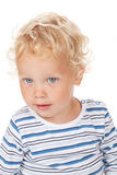 Bebê branco do cabelo encaracolado e dos olhos azuis Imagem de Stock