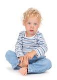 Bebê branco do cabelo encaracolado e dos olhos azuis Foto de Stock Royalty Free