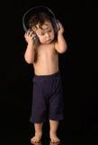 Bebê com auscultadores. Fotografia de Stock Royalty Free