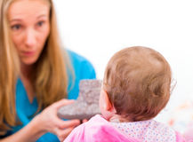 Bebê com baby-sitter Imagem de Stock Royalty Free