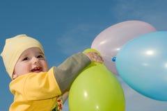 Bebê com balões Imagens de Stock Royalty Free