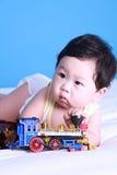Bebê com brinquedo Imagens de Stock