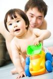 Bebê com brinquedo Fotografia de Stock