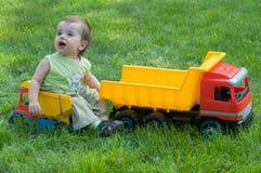 Bebê com caminhões do brinquedo Imagem de Stock Royalty Free