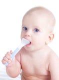 Bebê com colher Fotografia de Stock