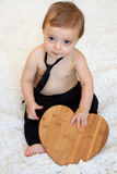 Bebê com coração Fotos de Stock