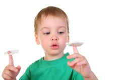 Bebê com enigma Imagens de Stock