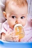 Bebê com frasco Foto de Stock Royalty Free