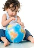 Bebê com globo do enigma. Fotos de Stock Royalty Free