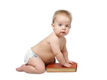 Bebê com livro vermelho Imagens de Stock