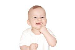 Bebê com mão em sua boca Fotos de Stock Royalty Free