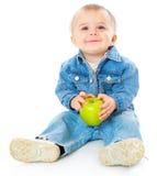 Bebê com maçã verde Fotografia de Stock Royalty Free