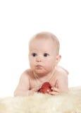 Bebê com maçã vermelha Fotografia de Stock Royalty Free