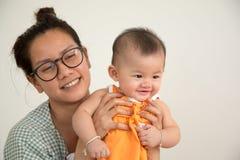 Bebê com mamã Imagens de Stock