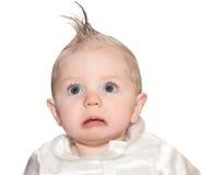 Bebê com mohawk falsificado e um olhar severo imagens de stock royalty free