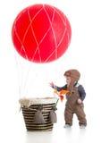 Bebê com o chapéu piloto no balão de ar quente Imagem de Stock