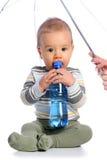 Bebê com o frasco da água Fotos de Stock Royalty Free