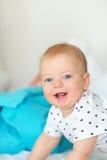 Bebê com olhos azuis Imagens de Stock