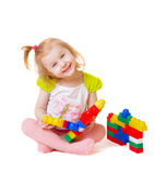 Bebê com os brinquedos isolados no branco Foto de Stock Royalty Free